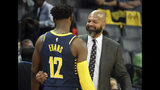 Memphis Grizzlies Coach J. B. Bickerstaff greets his former player Indiana Pacers Tyreke Evans (12) during a delay prior to the start of the first half of a preseason NBA basketball game Saturday, Oct. 6, 2018, in Memphis, Tenn. (AP Photo/Karen Pulfer Focht)