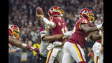 Marcus Davenport hits Redskins quarterback Alex Smith as the New Orleans Saints during Monday Night Football at the Mercedes-Benz Superdome. Monday, Oct. 8, 2018. The Saints won 43-19. (The Daily Advertiser via AP)