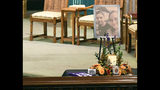 A urn with cremated ashes of Allison King is set in place as friends and family prepare for a funeral mass atSt. Stanislaus Roman Catholic Church in Amsterdam, N.Y., for eight of the 20 people killed in last Saturday's fatal limousine crash in Schoharie, N.Y., Saturday, Oct. 13, 2018. (AP Photo/Hans Pennink)