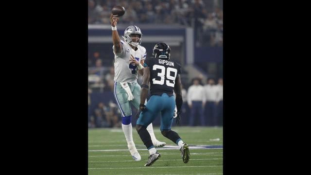 baafc8ca7 Dallas Cowboys quarterback Dak Prescott (4) passes under pressure from  Jacksonville Jaguars free safety Tashaun Gipson Sr. (39) in the first half  of an NFL ...