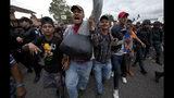 The Latest: Trump expands aid threat over migrant caravan