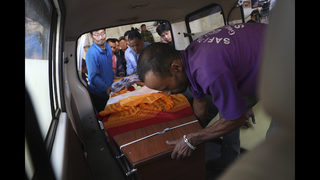 Weeping relatives receive bodies of South Korean climbers
