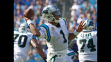 FILE - In this Sunday, Oct. 7, 2018, file photo, Carolina Panthers' Cam Newton (1) looks to pass against the New York Giants during the second half of an NFL football game in Charlotte, N.C. Newton has completed only one pass that traveled more than 20 yards beyond the line of scrimmage this season. He is also averaging just 6.8 yards per completion. But Newton's completion percentage under first-year offensive coordinator Norv Turner is a career-best 65.9. (AP Photo/Jason E. Miczek, File)