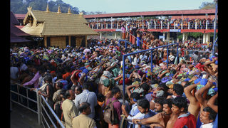 Indian temple priests turn back women, defying court ruling