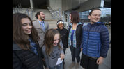 FILE - In this Nov. 10, 2016 file photo, five of the 21 youth plaintiffs in a federal climate change lawsuit against the federal government, including, from left, Sahara Valentine, 11, Jacob Lebel, 19, Avery McRae, 10, Miko Vergun, 15, Kelsey Julianna, 20, and Zealand Bell, 11, celebrate on the courthouse steps in Eugene, Ore., after U.S. District Judge Ann Aiken rejected requests from the federal government and trade groups representing many of the world's largest energy companies to dismiss their lawsuit. The U.S. government is trying once again to block a major climate change lawsuit days before young activists are set to argue at trial that the government has violated their constitutional rights by failing to take action climate change. On Thursday, Oct. 18, 2018, the Justice Department for a second time this year asked the U.S. Supreme Court to dismiss the case. The high court in July denied the request as premature. (Chris Pietsch /The Register-Guard via AP, File)