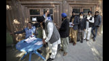 The Latest: Afghan official outraged by polls