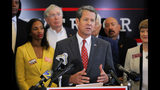 FILE- In this Aug. 29, 2018 file photo, Georgia Secretary of State and GOP gubernatorial candidate Brian Kemp speaks a press conference in Atlanta. The final stretch of the hotly contested Georgia governor's race is being consumed by a bitter political battle over access to the polls. Kemp says that Democratic gubernatorial candidate Stacey Abrams is fighting for immigrants without legal status to cast ballots in the Nov. 6 election. Abrams' campaign says that's untrue and Kemp is trying to deflect from his own record of making it harder for legal citizens to vote.(Bob Andres/Atlanta Journal-Constitution via APM File)