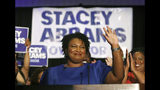 FILE- In this May 22, 2018, file photo Democratic candidate for Georgia Gov. Stacey Abrams waves at a campaign event in Atlanta. The final stretch of the hotly contested Georgia governor's race is being consumed by a bitter political battle over access to the polls. Secretary of State Brian Kemp, the Republican gubernatorial candidate, says that Abrams is fighting for immigrants without legal status to cast ballots in the Nov. 6 election. Abrams' campaign says that's untrue and Kemp is trying to deflect from his own record of making it harder for legal citizens to vote. (AP Photo/John Bazemore, File)