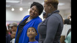 A voter speaks with gubernatorial candidate Stacey Abrams as they wait in line for their ballots during early voting at The Gallery at South DeKalb Mall in Decatur, Monday, October 22, 2018. Today marks only 15 days left until Election Day on Tuesday, November 6.(Alyssa Pointer/Atlanta Journal-Constitution via AP)