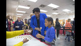 Georgia gubernatorial candidate Stacey Abrams receives a voting sticker with her nephew, Cameron McLean, after casting her ballot during early voting at The Gallery at South DeKalb Mall in Decatur, Monday, October 22, 2018. Today marks only 15 days left until Election Day on Tuesday, November 6. (Alyssa Pointer/Atlanta Journal-Constitution via AP)