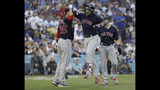 Boston Red Sox's Steve Pearce celebrates with J.D. Martinez (28) and Andrew Benintendi after hitting a two-run home run during the first inning in Game 5 of the World Series baseball game on Sunday, Oct. 28, 2018, in Los Angeles. (AP Photo/David J. Phillip)