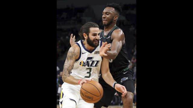 4ffd5c18 Utah Jazz's Ricky Rubio, left, of Spain, drives as Minnesota Timberwolves'  Josh Okogie, of Nigeria, defends during the first half of an NBA basketball  game ...