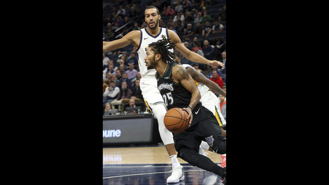 de868e38 Minnesota Timberwolves' Derrick Rose drives around Utah Jazz's Rudy Gobert  during the second half of an NBA basketball game Wednesday, Oct. 31, 2018,  ...