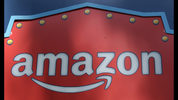 FILE- This Oct. 23, 2018, file photo shows an Amazon logo atop the Amazon Treasure Truck The Park DTLA office complex in downtown Los Angeles. Amazon launched a program Thursday, Nov. 1, that aims to teach more than 10 million students a year how to code. (AP Photo/Richard Vogel, File)