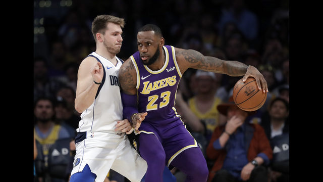 655bcf54a26 Los Angeles Lakers  LeBron James (23) is defended by Dallas Mavericks  Luka  Doncic during the first half of an NBA basketball game Wednesday