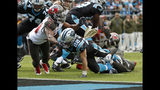 Carolina Panthers' Christian McCaffrey (22) runs for a touchdown as Tampa Bay Buccaneers' Adarius Taylor (53) defends in the first half of an NFL football game in Charlotte, N.C., Sunday, Nov. 4, 2018. (AP Photo/Nell Redmond)