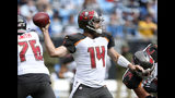 Tampa Bay Buccaneers' Ryan Fitzpatrick (14) looks to pass against the Carolina Panthers in the first half of an NFL football game in Charlotte, N.C., Sunday, Nov. 4, 2018. (AP Photo/Mike McCarn)