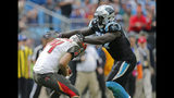 Tampa Bay Buccaneers' Ryan Fitzpatrick (14) is sacked by Carolina Panthers' Mario Addison (97) in the first half of an NFL football game in Charlotte, N.C., Sunday, Nov. 4, 2018. (AP Photo/Nell Redmond)