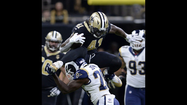 New Orleans Saints Running Back Alvin Kamara  Leaps Over Los Angeles Rams Free Safety Lamarcus Joyner  On A Rushing Play In The Second Half Of An