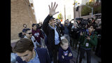 Rep. Beto O'Rourke, the 2018 Democratic Candidate for the Senate in Texas, waves to supporters as he leaves a polling place with his family after voting, Tuesday, Nov. 6, 2018, in El Paso, Texas. (AP Photo/Eric Gay)
