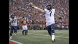 FILE - In this Saturday, Nov. 3, 2018, file photo, West Virginia quarterback Will Grier (7) scores the game-winning, two-point conversion during an NCAA college football game against Texas in Austin, Texas. Grier has thrown for 699 yards and six touchdowns without an interception in his last two games. (Nick Wagner/Austin American-Statesman via AP, File)