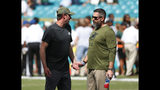 FILE - In this Nov. 4, 2018, file photo, Miami Dolphins coach Adam Gase, left, talks to defensive coordinator Matt Burke before the team's NFL football game against the New York Jets in Miami Gardens, Fla. Dolphins' Reshad Jones mysteriously took himself out of last week's win over the Jets and watched the second half from the sideline. In the aftermath, Gase said communication problems between Burke and players needed to be addressed. (AP Photo/Wilfredo Lee, File)