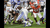 Duke running back Deon Jackson (25) runs past Miami linebacker Shaquille Quarterman (55) on his way to a touchdown during the first half of an NCAA college football game Saturday, Nov. 3, 2018, in Miami Gardens, Fla. (AP Photo/Lynne Sladky)