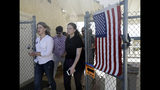 FILE - In this Tuesday, Nov. 6, 2018 file photo, Katie Hill, left, a Democratic candidate from California's 25th congressional district leaves a polling station after voting in Agua Dulce, Calif. Hill defeated Republican incumbent Steve Knight. (AP Photo/Marcio Jose Sanchez)