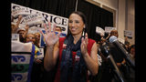 FILE - In this Tuesday, Nov. 6, 2018 file photo, Democratic house candidate Sharice Davids prepares to speak to supporters at a victory party in Olathe, Kan. Davids defeated Republican incumbent Kevin Yoder to win the Kansas' 3rd Congressional District seat. (AP Photo/Colin E. Braley)