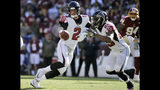 FILE - In this Sunday, Nov. 4, 2018, file photo, Atlanta Falcons quarterback Matt Ryan (2) fakes a handoff to running back Ito Smith (25) during an NFL football game against the Washington Redskins, in Landover, Md. Ryan is playing like he did as an MVP in 2016, throwing 10 touchdown passes and just three interceptions. (AP Photo/Mark Tenally, File)