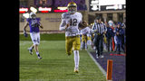 Notre Dame's Ian Book (12) runs for a touchdown against Northwestern during an NCAA college football game in Evanston, Ill., Saturday, Nov. 3, 2018. (Michael Caterina/South Bend Tribune via AP)