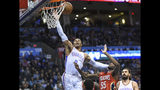 Oklahoma City Thunder guard Russell Westbrook (0) puts up a shot over New Orleans Pelicans forward E'Twaun Moore (55) in the second half of an NBA basketball game in Oklahoma City, Monday, Nov. 5, 2018. (AP Photo/Kyle Phillips)