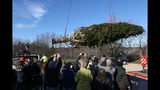 The Rockefeller Center Christmas tree is hoisted by crane to a flatbed truck, Thursday, Nov. 5, 2018 in Wallkill, N.Y. It will be transported to Manhattan where it will be erected at Rockefeller Center this weekend. The 72-foot-tall (22-meter) Norway spruce will be lit in a televised ceremony on Nov. 28 and remain on display until Jan 7. (Patrick Oehler/Poughkeepsie Journal via AP)