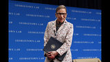 FILE - In this Sept. 26, 2018, file photo, Supreme Court Justice Ruth Bader Ginsburg leaves the stage after speaking to first-year students at Georgetown Law in Washington. Ginsburg has been hospitalized after fracturing three ribs in fall at court (AP Photo/Jacquelyn Martin, File)