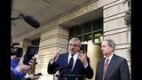 Attorney Paul Kamenar, center, speaks to reporters outside federal court in Washington, Thursday, Nov. 8, 2018, as Peter Flaherty, right, Chairman and Chief Executive Officer of the National Legal and Policy Center, listens. Judges on a federal appeals court heard arguments from Kamenar and are weighing whether to invalidate the Russia investigation over arguments made a former aide to longtime Trump confidante Roger Stone that the special counsel's appointment was unconstitutional. (AP Photo/Susan Walsh)