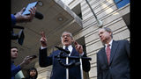 Attorney Paul Kamenar, left, joined by Chairman of the National Legal Policy Center, Peter Flaherty, speaks to media as they leave federal court in Washington, Thursday, Nov. 8, 2018. Judges on a federal appeals court heard arguments from Kamenar and are weighing whether to invalidate the Russia investigation over arguments made a former aide to longtime Trump confidante Roger Stone that the special counsel's appointment was unconstitutional. (AP Photo/Carolyn Kaster)