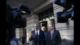 From left, attorney Paul Kamenar, joined by Don Santarelli, center, and chairman of the National Legal Policy Center, Peter Flaherty, speaks to media as they leave federal court in Washington, Thursday, Nov. 8, 2018. Judges on a federal appeals court heard arguments from Kamenar and are weighing whether to invalidate the Russia investigation over arguments made a former aide to longtime Trump confidante Roger Stone that the special counsel's appointment was unconstitutional. (AP Photo/Carolyn Kaster)