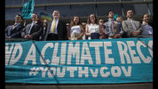 FILE - In this July 18, 2018, file photo, lawyers and youth plaintiffs lineup behind a banner after a hearing before Federal District Court Judge Ann Aiken between lawyers for the Trump Administration and the so called Climate Kids in Federal Court in Eugene, Ore. The lawsuit against the U.S. government for being slow to address climate change is on hold again, after a federal appeals court Thursday, Nov. 8, 2018, granted the Trump administration's motion for a temporary stay. The constitutional climate lawsuit was brought by 21 young Americans and is supported by Our Children's Trust. (Chris Pietsch/The Register-Guard via AP, File)