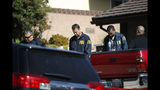 FBI agents leave the house of shooting suspect David Ian Long after conducting a search in Newbury Park, Calif., on Thursday, Nov. 8, 2018. Authorities said the former Marine opened fire at a country music bar in Southern California on Wednesday evening. (AP Photo/Jae C. Hong)