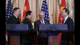 From left, Secretary of State Mike Pompeo, Chinese State Councilor and Defense Minister General Wei Fengheat, Secretary of Defense Jim Mattis, and Chinese Politburo Member Yang Jiechi shake hands at the conclusion of a news conference at the State Department in Washington, Friday, Nov. 9, 2018. (AP Photo/Carolyn Kaster)