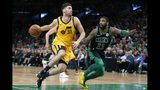 Utah Jazz's Georges Niang (31) drives for the basket against Boston Celtics' Kyrie Irving (11) during the first half on an NBA basketball game in Boston, Saturday, Nov. 17, 2018. (AP Photo/Michael Dwyer)