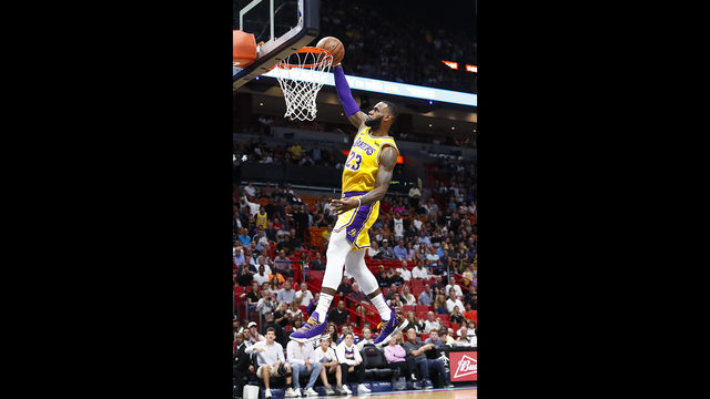 1e57afb2b Los Angeles Lakers forward LeBron James scores during the first quarter of  an NBA basketball game against the Miami Heat