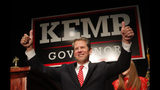 FILE - In a Nov. 7, 2018 file photo, Georgia Republican gubernatorial candidate Brian Kemp gives a thumbs-up to supporters, in Athens, Ga. Georgia governor-elect Brian Kemp on Monday, Nov. 19, 2018 unveiled a transition team that includes former U.S. Health and Human Services Secretary Tom Price to begin building out his administration.(AP Photo/John Bazemore, File)