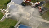 In this image made from a video provided by WABC firefighters battle a fatal fire on Tuesday, Nov. 20, 2018, in Colts Neck, N.J. The Monmouth County prosecutor's office says the fire has taken multiple victims. (WABC via AP)