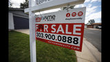 FILE- In this Oct 2, 2018, file photo a for sale sign stands outside a home on the market in the north Denver suburb of Thornton, Colo. On Wednesday, Nov. 21, Freddie Mac reports on this week's average U.S. mortgage rates. (AP Photo/David Zalubowski, File)