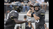 "FILE - In this Nov. 10, 2018, file photo, Central Florida quarterback McKenzie Milton, right, throws a pass to running back Adrian Killins Jr. (9) during the first half of an NCAA college football game against Navy in Orlando, Fla. No. 8 UCF isn't content with having the nation's longest winning streak. The Knights want more. A lot more. The defending American Athletic Conference champions can complete a second consecutive undefeated regular season by beating intrastate rival South Florida on Friday, Nov. 23. ""From where this program's come, it's just getting started,"" Milton said. ""I think we're just scratching the surface and UCF is going to be good for a very, very long time."" (AP Photo/Phelan M. Ebenhack, File)"