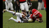 Georgia Tech quarterback TaQuon Marshall (16) is stopped for a loss by Georgia defensive end Jonathan Ledbetter (13) during the first half of an NCAA college football game Saturday, Nov. 24, 2018, in Athens, Ga. (AP Photo/John Bazemore)