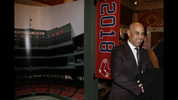 Boston Red Sox manager Alex Cora smiles as he walks the red carpet prior to the premiere of
