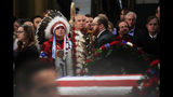 Native Americans Donald Woody, left, and Warren Stade of the Shakopee Mdewakanton Sioux Community tribe in Prior Lake, Minn., pay their last respects to former President George H.W. Bush as he lies in state at the U.S. Capitol in Washington, Tuesday, Dec. 4, 2018. (AP Photo/Manuel Balce Ceneta)