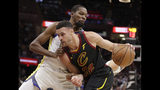 Cleveland Cavaliers' Larry Nance Jr. (22) drives past Golden State Warriors' Kevin Durant (35) in the first half of an NBA basketball game, Wednesday, Dec. 5, 2018, in Cleveland. (AP Photo/Tony Dejak)
